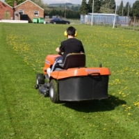 Josh mowing the grass 2 days before the rally