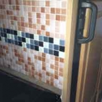 I went for mosaic tiles as they are thin and will cope better with the flex in the walls.